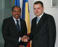 Michel Sidibé (left) met with Mr Ion Bazac
